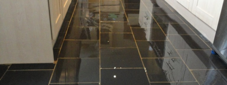 Dull and Stained Semi Riven Black Slate Floor Tiles in Kettering