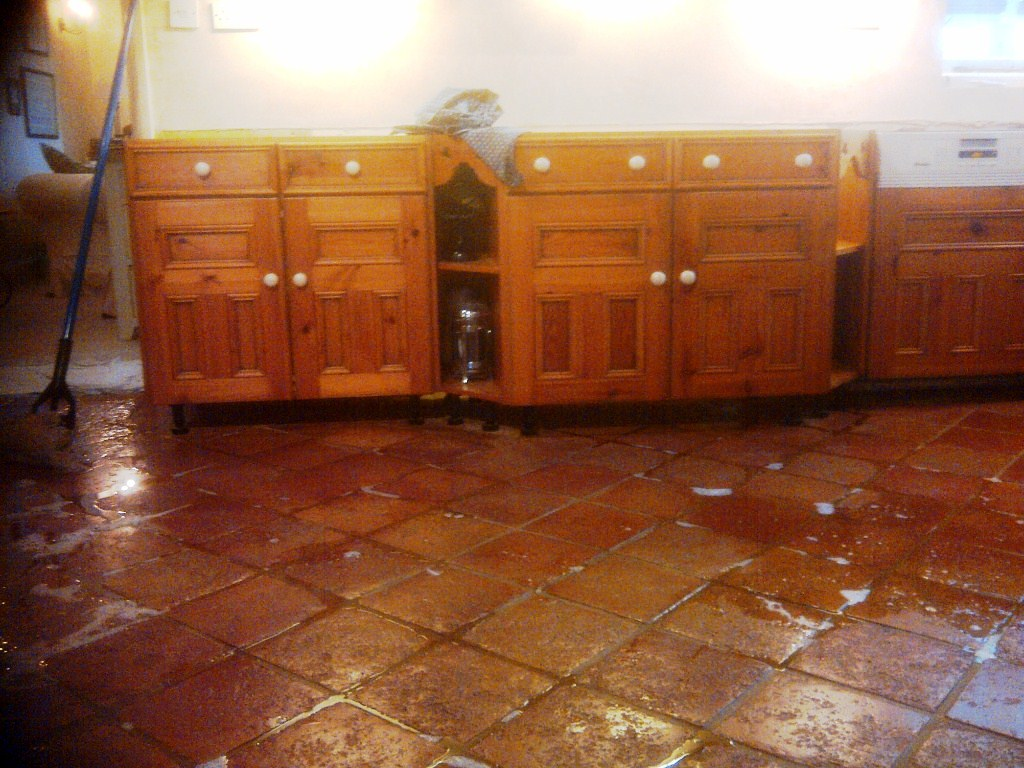 Quarry Tiled Kitchen Floor During Cleaning