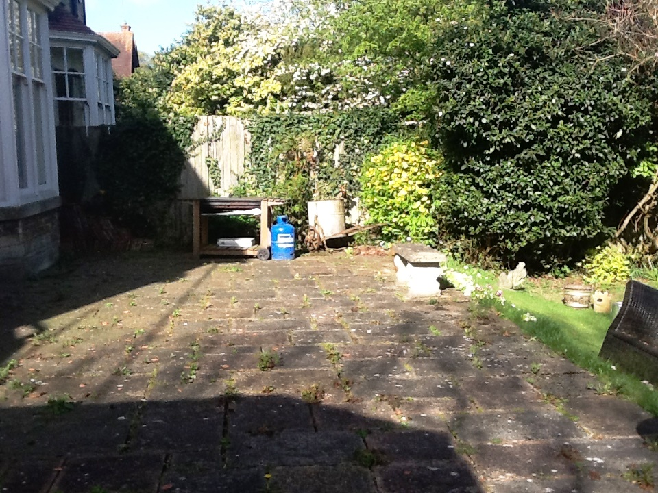 Patio Before Cleaning and Repointing in Rushden