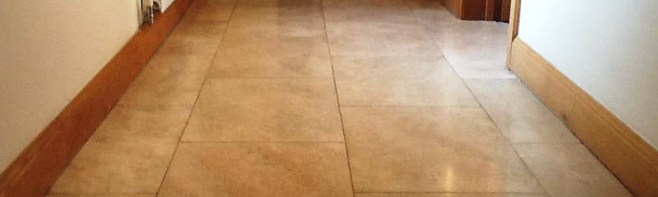 Renovating A Badly Stained And Hole-Marked Travertine Tiled Floor In Oundle