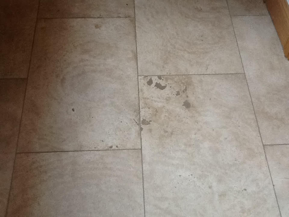 Stained Travertine Hallway Oundle Before Cleaning