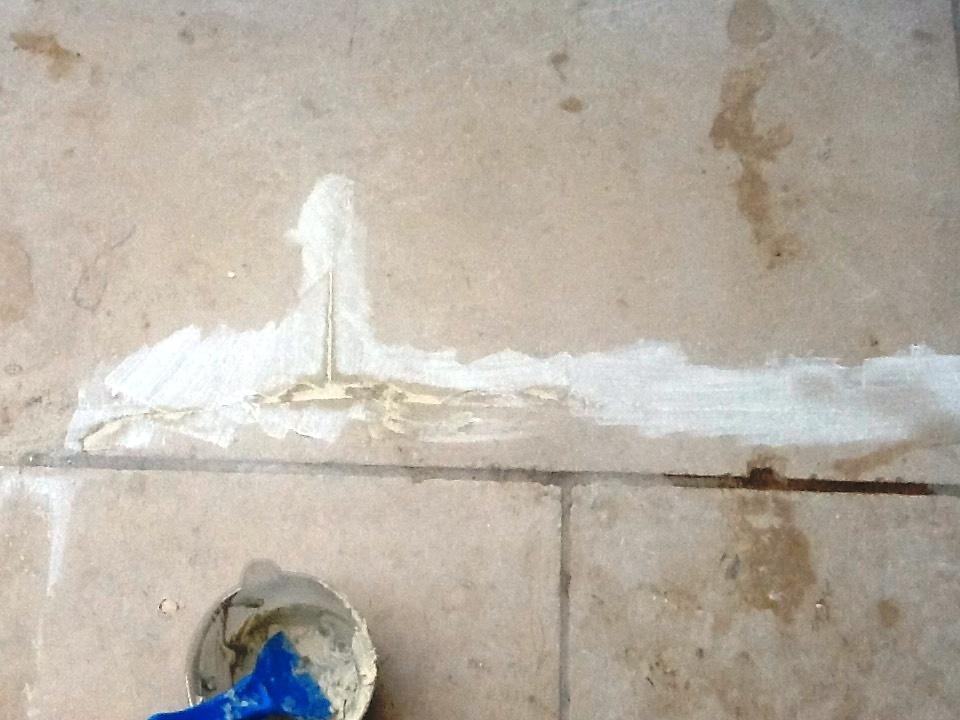 Repairing a Limestone tiled Conservatory floor in Grafton Underwood