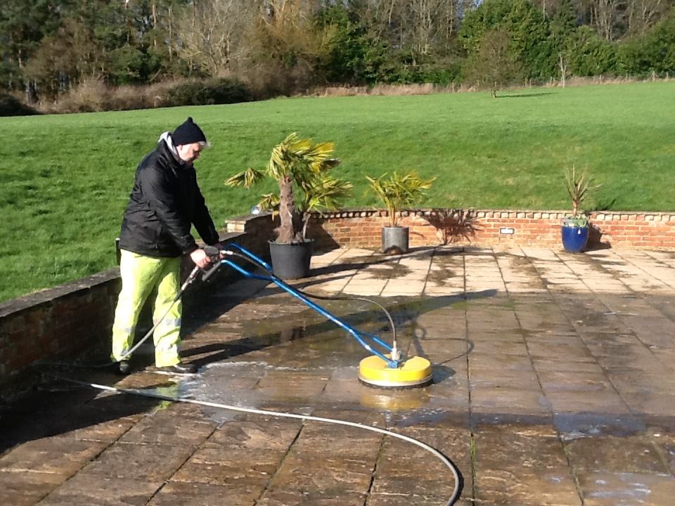 Power Washing a large patio in Northamtonshire with an industrial pressure washing machine
