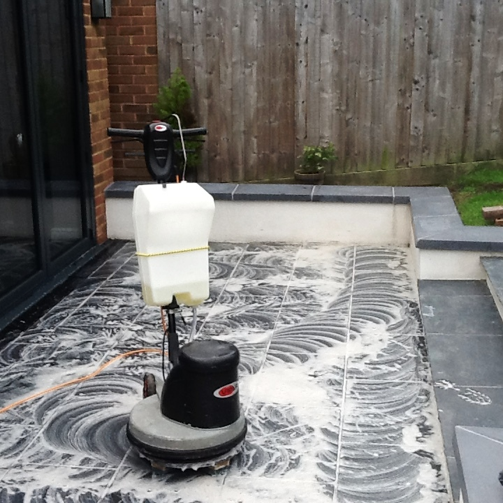Patio Slate Tiles with Grout Haze Being Cleaned in Brackley