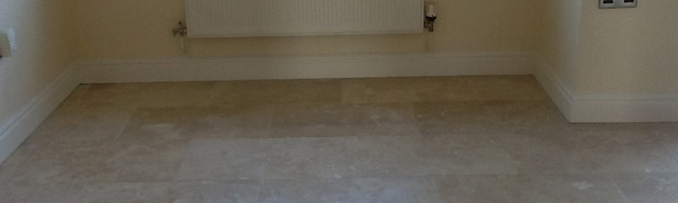 Polished Travertine Tiles with Pitting Issues Restored in Oundle