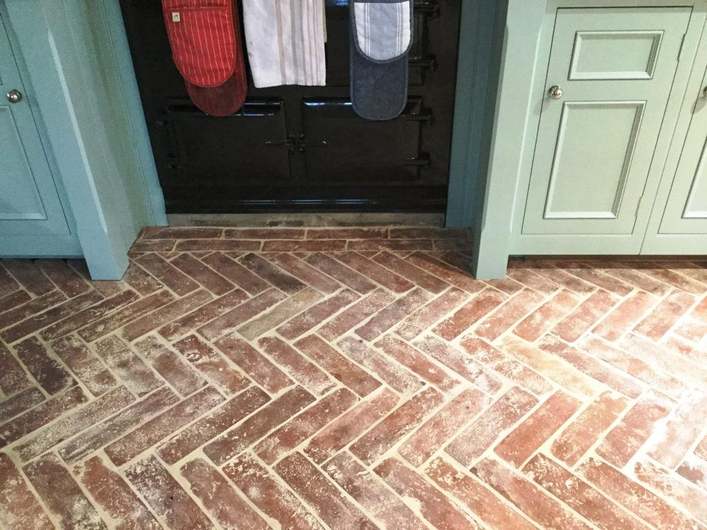 Herringbone design terracotta floor before Cogenhoe