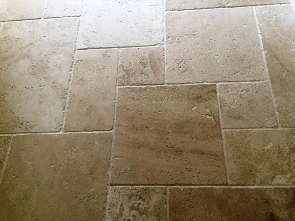Travertine tile after burnishing Steverton