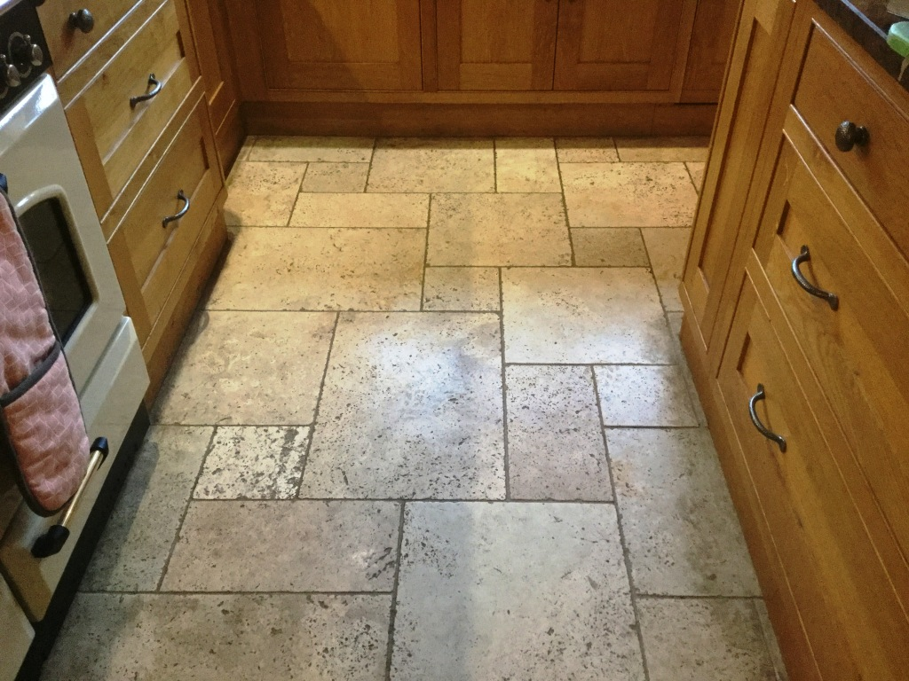 Tumbled Travertine Kitchen floor Before Cleaning in Lower Boddington